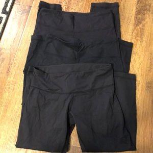3 pairs of Lululemon Wunder Under crop leggings.